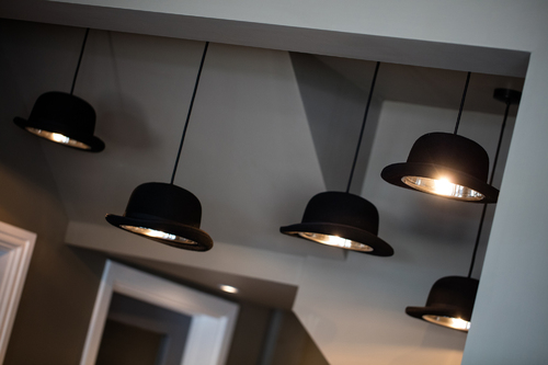 Bowler hats lights above reception